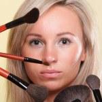 Beautiful young woman make-up brush yellow — Stock Photo #13750937