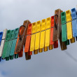 Old coloured clothes peg a under the sky - Stock Photo