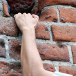 Stock Photo: Businessman climbing to success, hand on wall