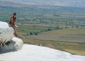 Woman in Travertine pools and terraces, Pamukkale, Hierapolis Turkey. — Stock Photo