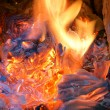 Burning billets in old fireplace — Stock Photo
