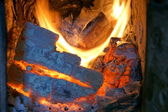 Burning billets in old fireplace — Stockfoto