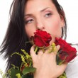 Closeup portrait of attractive young woman holding a red rose — Stock Photo #14041384