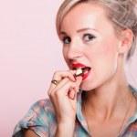 Pinup girl Woman eating chocolate portrait — Stock Photo