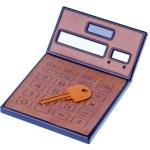 Brown calculator and orange key on white background — Stock Photo