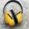 Stock Photo: Ear protection factory noise muffs Yellow