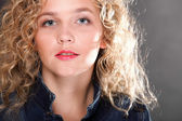 Young beautiful woman with long curly blond hair — Stockfoto