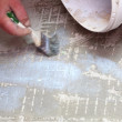 Construction brush worker is tiling at home tile floor adhesive — Stock Photo