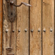 Old wooden door. Metallic knob — Stok fotoğraf