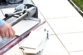 Man cutting tile by cutter — Foto Stock