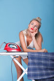 Pin up girl retro style portrait woman ironing — Stock Photo