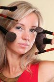 Beautiful young woman make-up brush yellow — Stock Photo