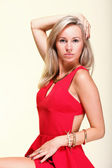 Lady in red woman dress yellow background — Stock Photo