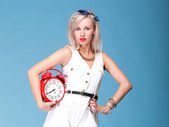 Full lenght Portrait pretty young woman red clock — Stock Photo