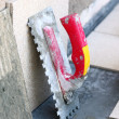 Mortar on wall construction notched trowel — Stock Photo