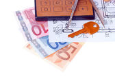 Calculator and euromoney note — Stock Photo