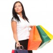 Portrait cheerful businesswoman holding shopping bags — Stock Photo #16471911
