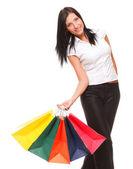 Retrato de jovem carregando sacolas de compras — Foto Stock