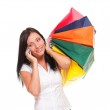 Portrait of cute young woman with mobile phone while holding shopping bags — Stock Photo #16617919