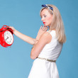 Portrait pretty young woman red clock — Stock Photo