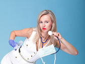 Sexual woman in nurse suit with stethoscope blue — Stock Photo