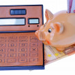 Stock Photo: Piggy bank, calculator and euro currency