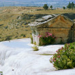 Tomb and terraces with water, Pamukkale, Turkey - Stock Photo