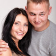 Portrait of a beautiful young happy smiling couple isolated — Stock Photo #16934135