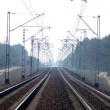 Rail Road Tracks - electrical - Stock Photo
