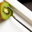 Stock Photo: Kiwi with tablespoon