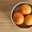 Bowl with three mandarines - Stock Photo