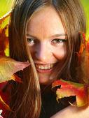 Autumn woman on leafs background — Stock fotografie