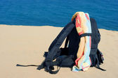 Sand, beach and rucksack — Stock Photo