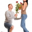 Attractive young couple gift rose in hand isolated — Stock Photo