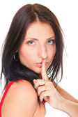 Woman keep quiet gesture finger on mouth isolated — Stock Photo