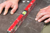 Construction level tiling at home tile floor adhesive — Stock Photo