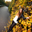 Woman girl portret in autumn green leaf wall - Stock Photo