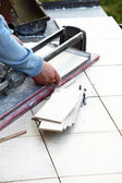 Man cutting tile by cutter — Stock Photo