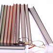 Stock Photo: Hardcover books and glasses on White Background