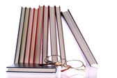 Hardcover books and glasses on White Background — Stock Photo