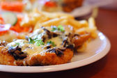 Chicken steak with fries. chips and salad — Stock Photo