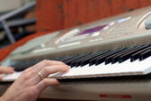 Hands pianist and piano player — Stock Photo
