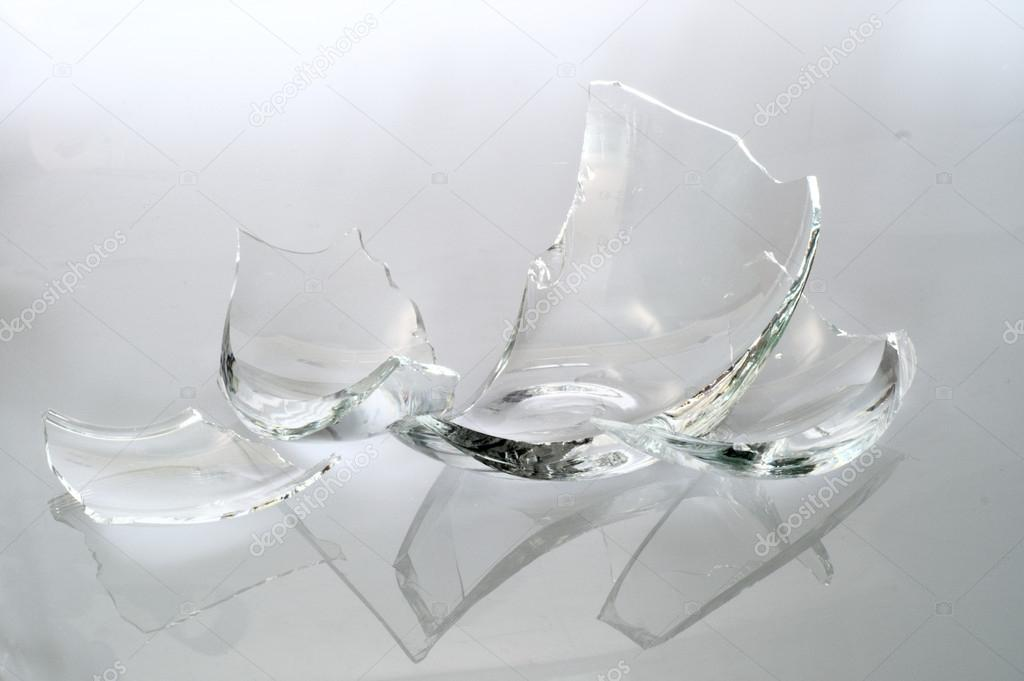 Broken glass pieces stock photo voyagerix 19399835 for What to do with broken mirror pieces
