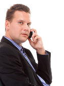 Businessman speaking on his mobile isolated — Foto Stock