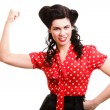 Cheerful pin up woman flexing biceps isolated — Stock Photo #19786121