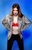 Sexy woman in fur coat and red bra — Stock Photo