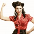 Cheerful pin up woman flexing biceps isolated - Stock Photo