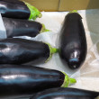Black eggplants in market — Foto Stock