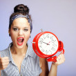 Woman with red clock. Time management concept. — Stock Photo #20247493