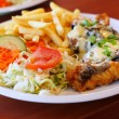 Chicken steak with fries chips and salad — Stock Photo